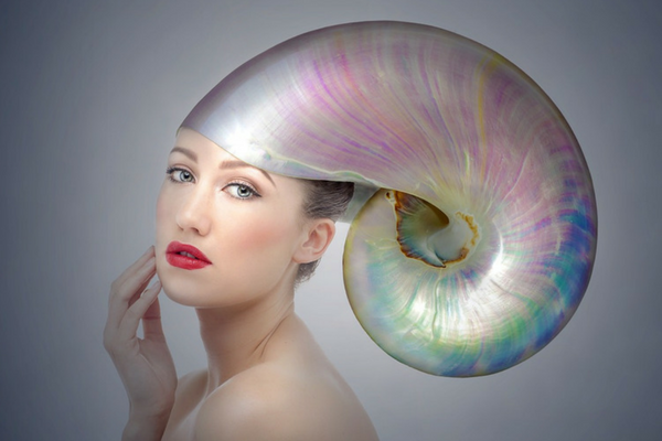 Fashion picture of a lady wearing a shell on her head relating to pearls of wisdom